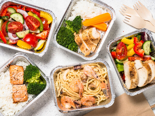 Food delivery concept - healthy lunch in boxes.